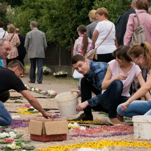 People creating flower carpets